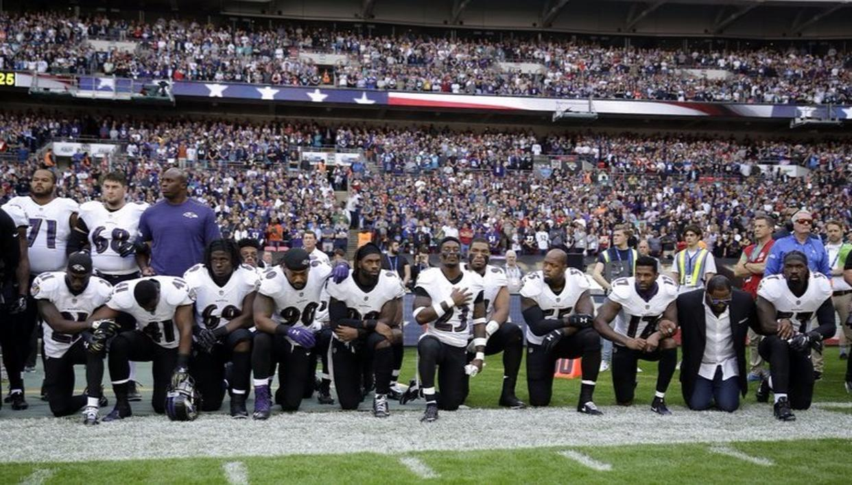 Baltimore Ravens player including former player Ray Lewis kneel down during the national anthem before their game against Jacksonville Jaguars at Wembley.