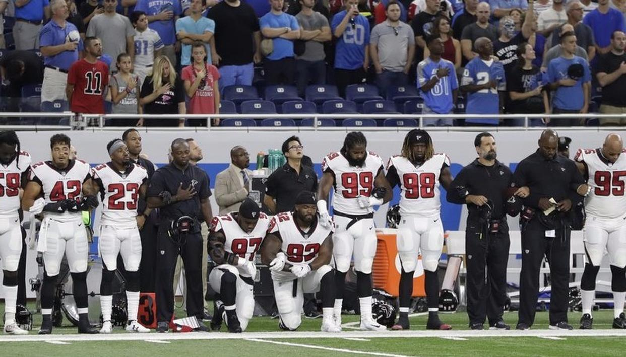 Atlanta Falcons defensive tackles Grady Jarrett and Dontari Poe take the knee during the national anthem