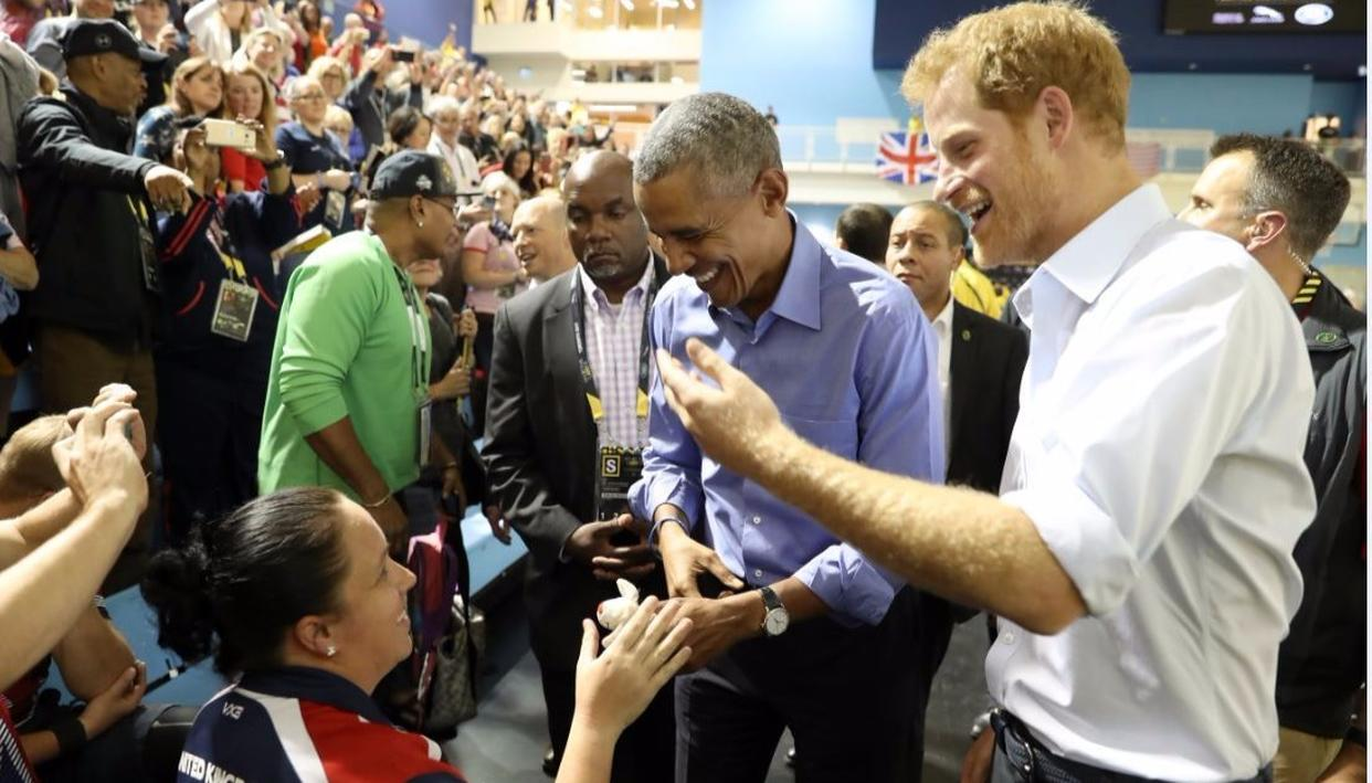 Harry and Obama greet members of public Credit: Getty Images
