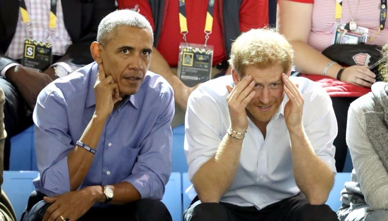 Harry and Obama watch the games anxiously. Credit: Getty Images