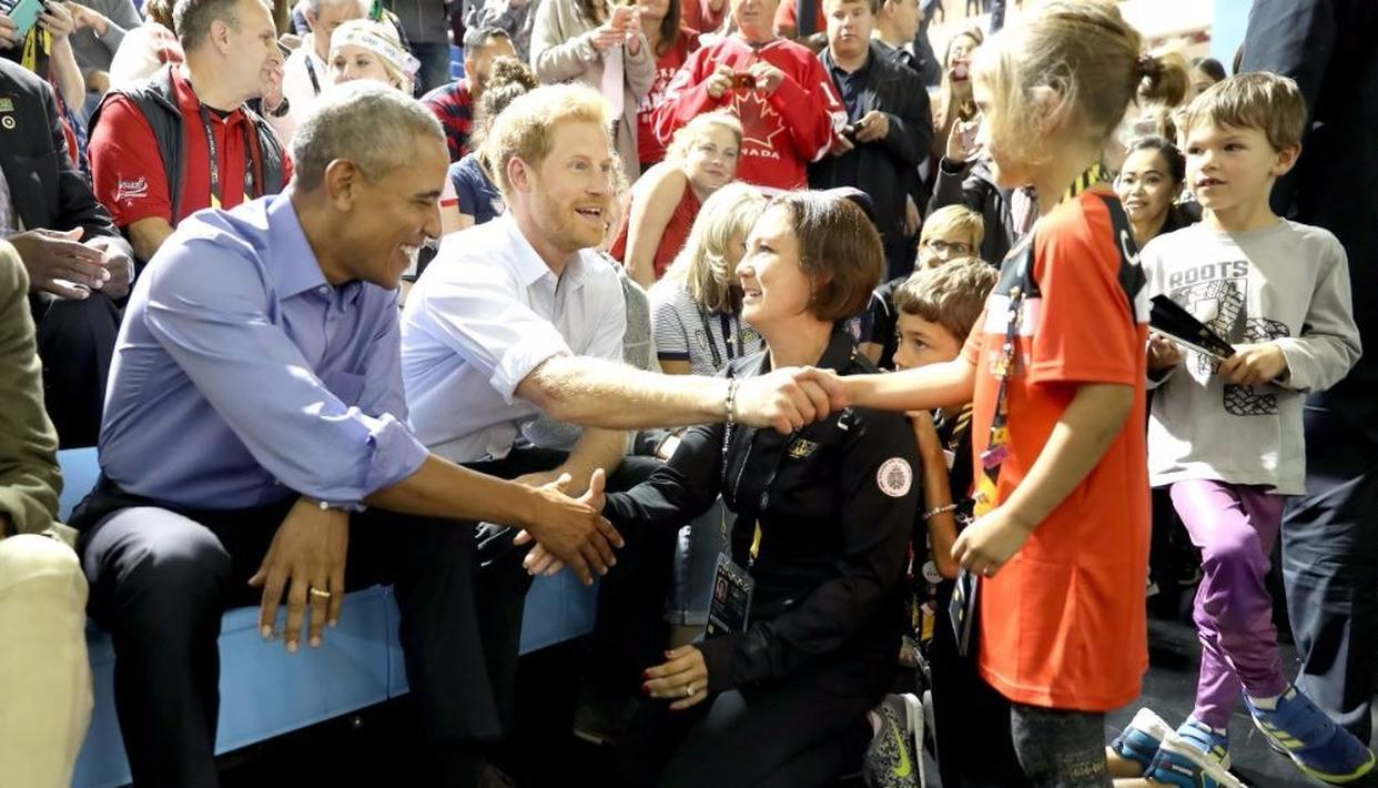 Harry and Obama meet members of public Credit: Getty Images