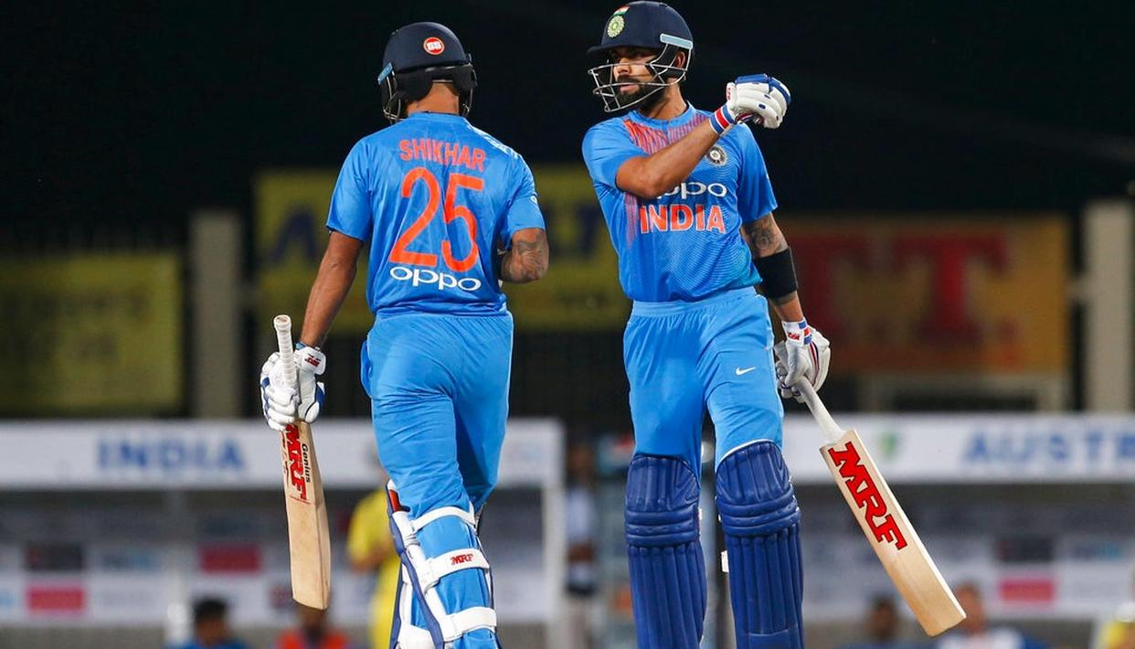 Virat Kohli and Shikar Dawan interact during the first T20I.