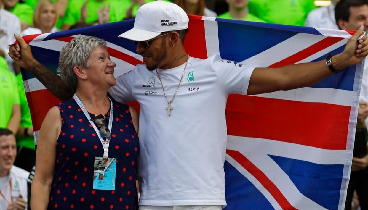 Lewis Hamilton, of Britain, celebrates with his mother Carmen Larbalestier at the pit lane after the Formula One Mexico Grand Prix auto race at the Hermanos Rodriguez racetrack in Mexico City.