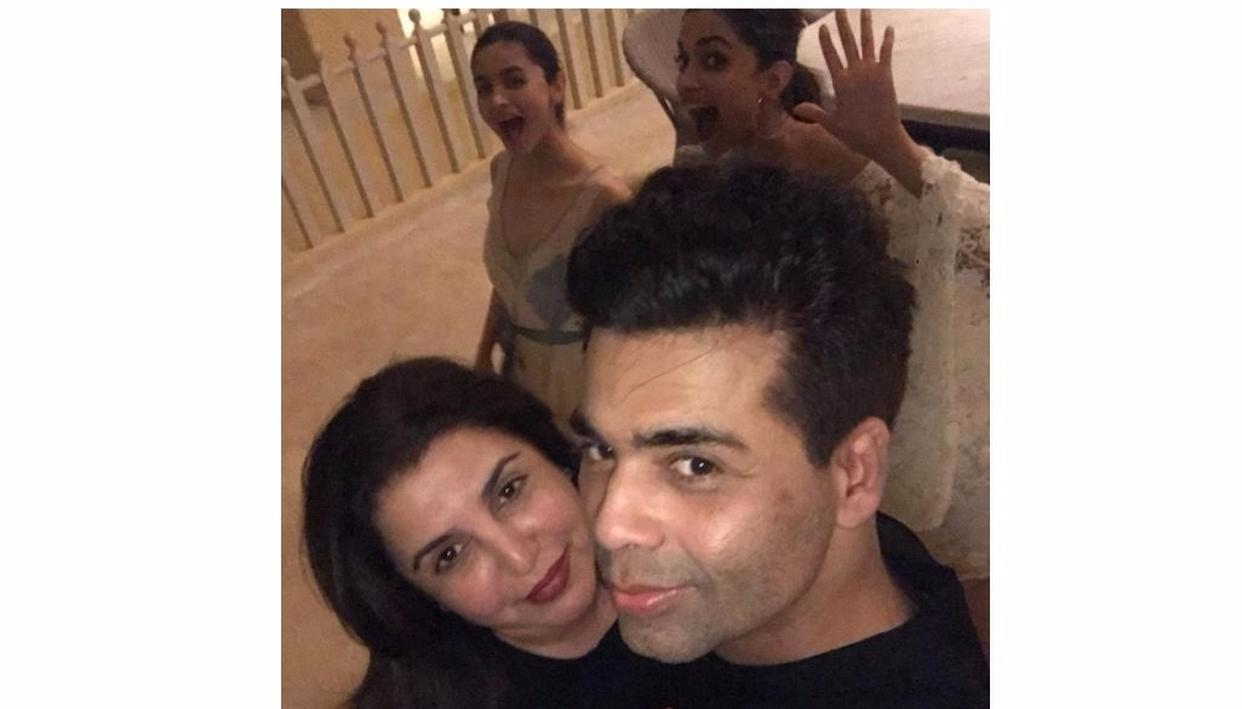 Now, we know. The duo decide to photobomb Farah Khan and Karan Johar and do it with great success.