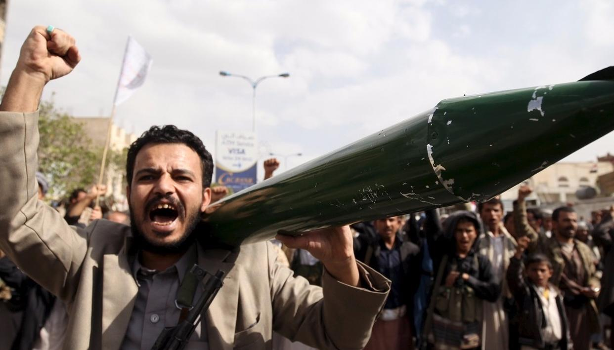 A Houthis supporter carries mock missile protesting against USA in Sanah, Yemen. Image - Reuters