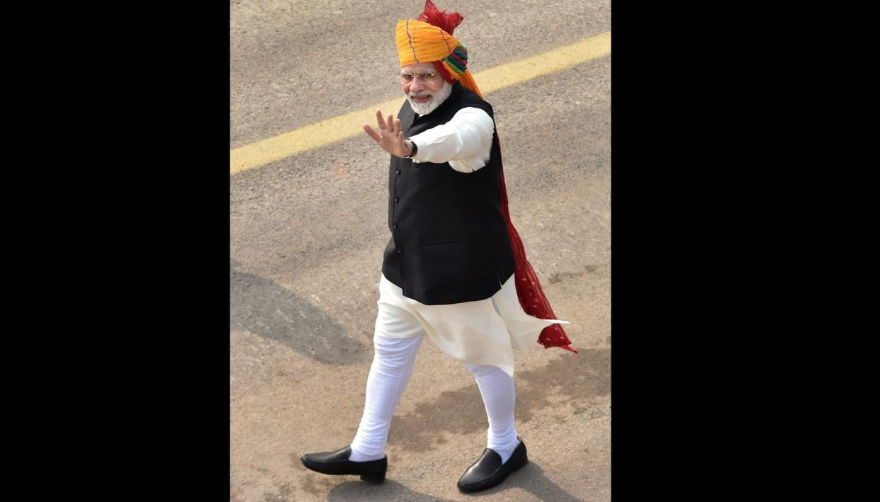 Prime Minister Narendra Modi waves at the crowd during the 69th Republic Day Parade at Rajpath in New Delhi, on Friday.  (Source: PTI)