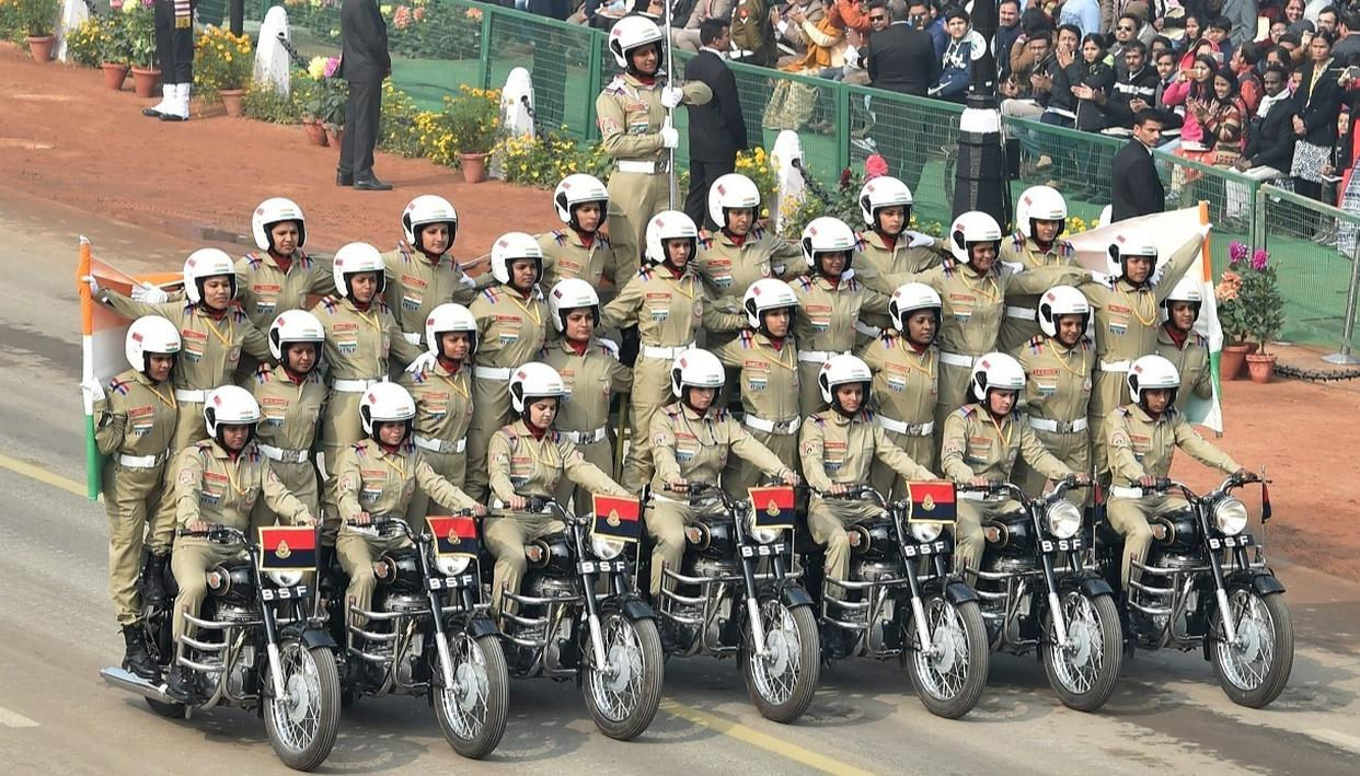 An all-women team of BSF performs on motorcycles during the 69th Republic Day Parade at Rajpath in New Delhi, on Friday.  (Source: PTI)