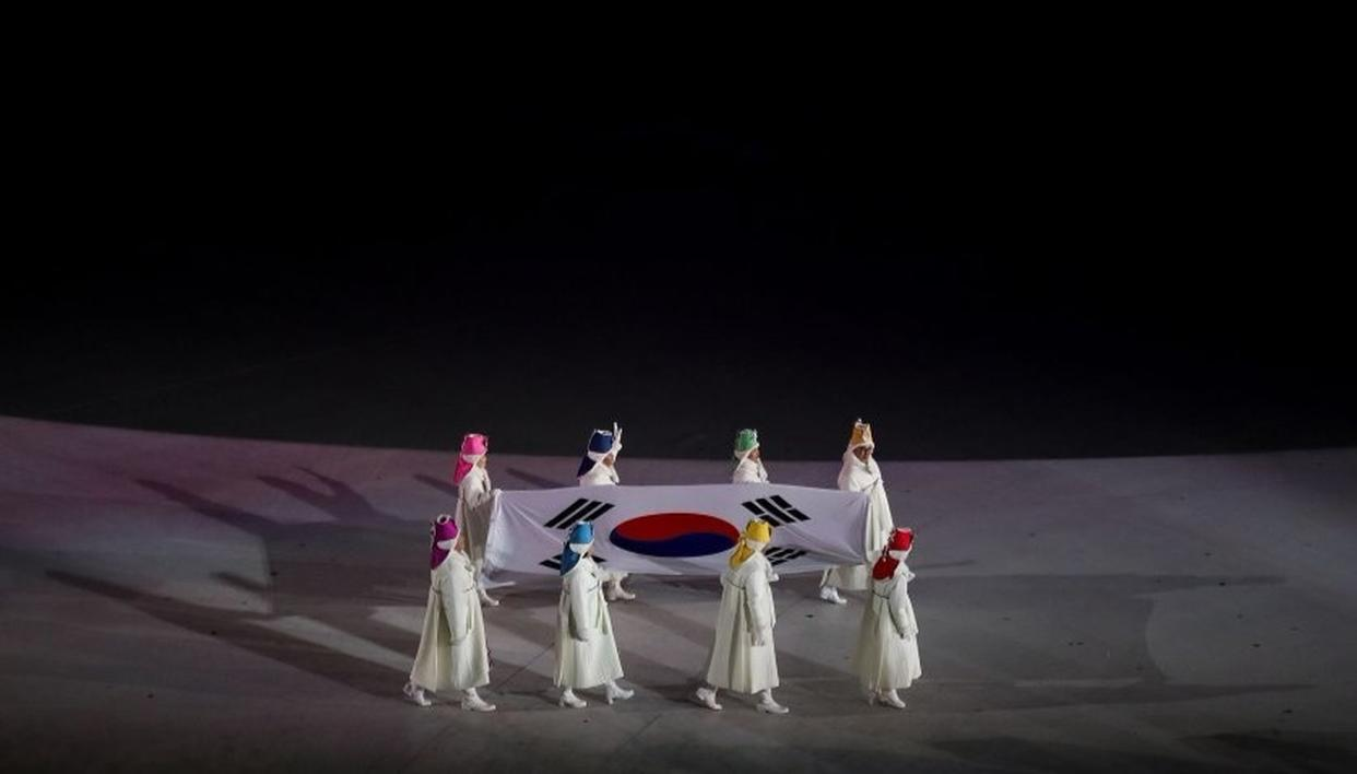 Former South Korean Olympians carry the South Korean flag during the opening ceremony of the Pyeongchang 2018