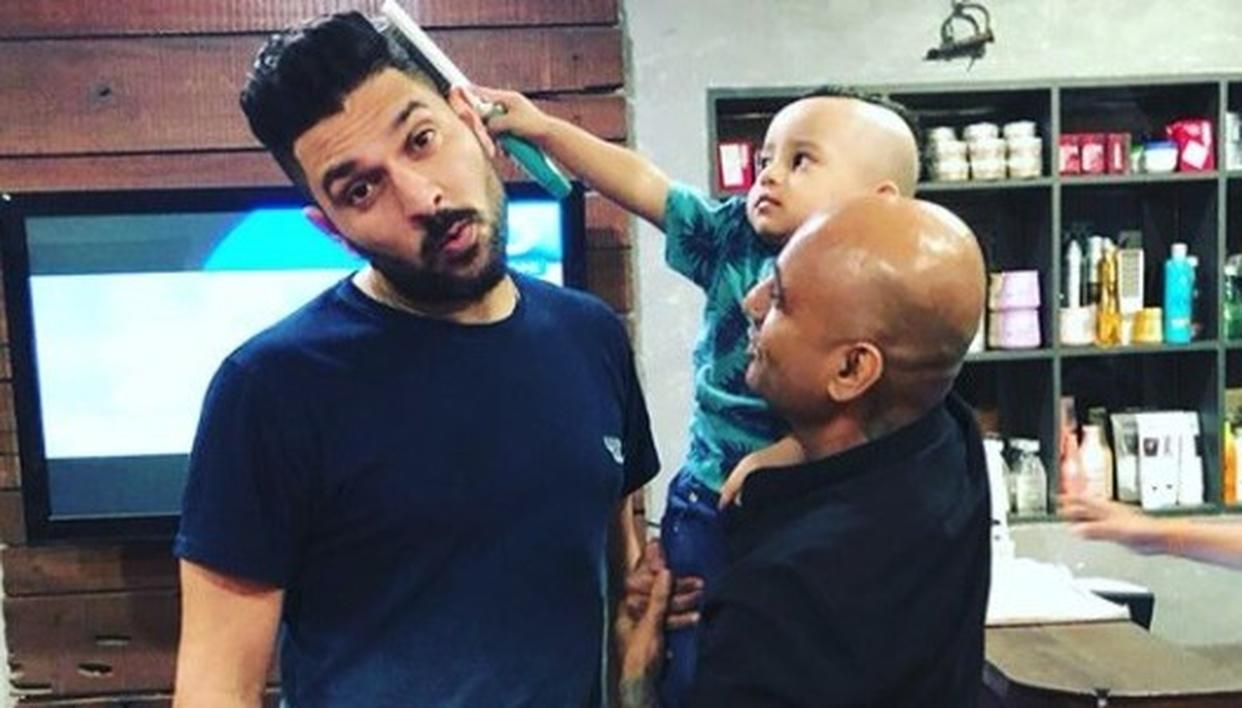 YUVRAJ  'FORCED'  TO GET A NEW HAIRCUT
