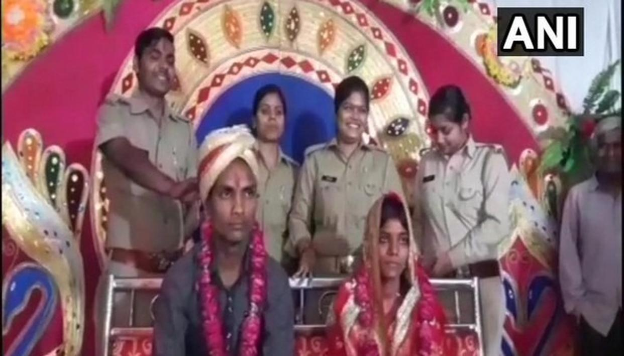 COUPLE TIES THE KNOT AT A POLICE STATION
