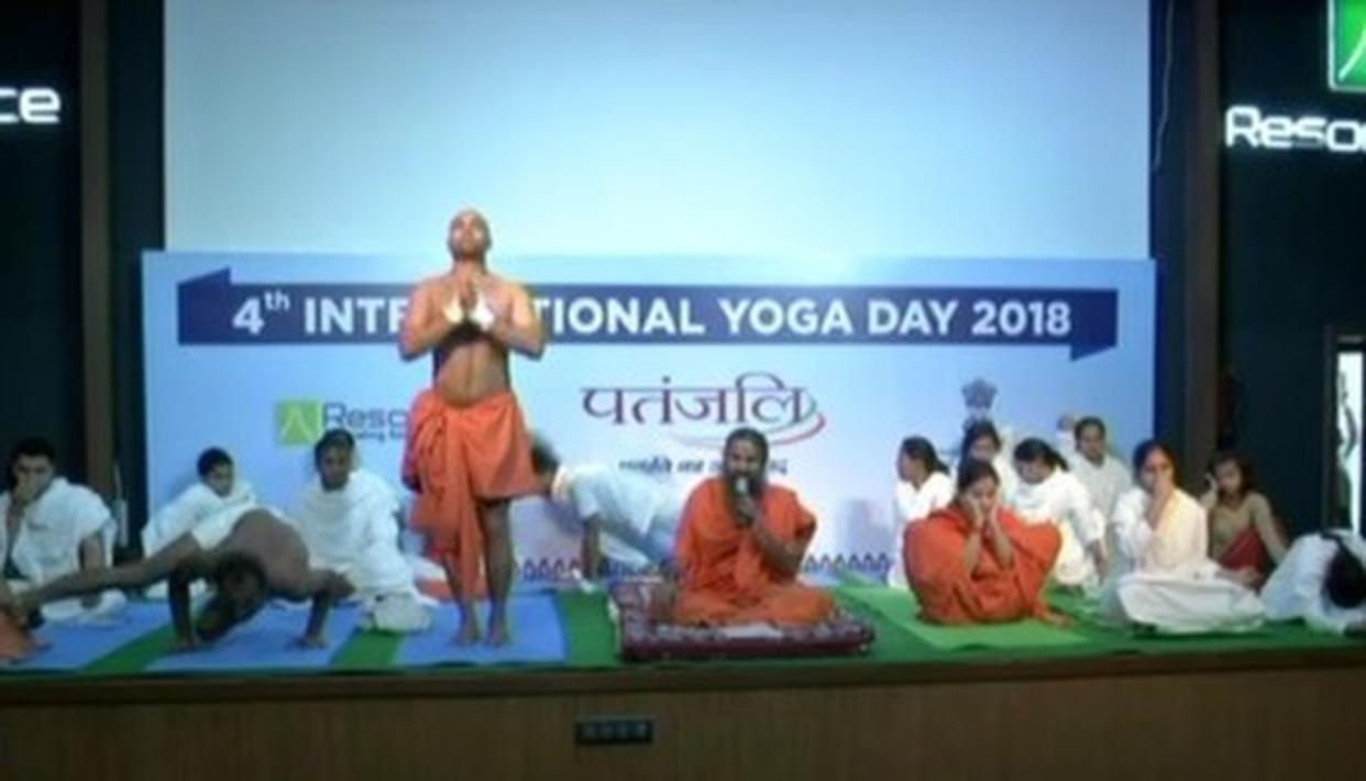 WATCH: PATANJALI WORKERS PERFORMING YOGA STUNTS ON STAGE