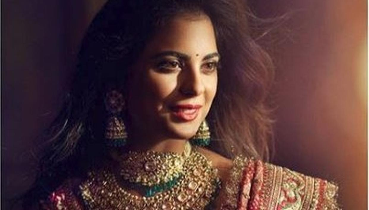 BRIDE-TO-BE ISHA AMBANI LOOKS ETHEREAL IN RED SABYASACHI LEHENGA AT HER GRAHA SHANTI POOJA