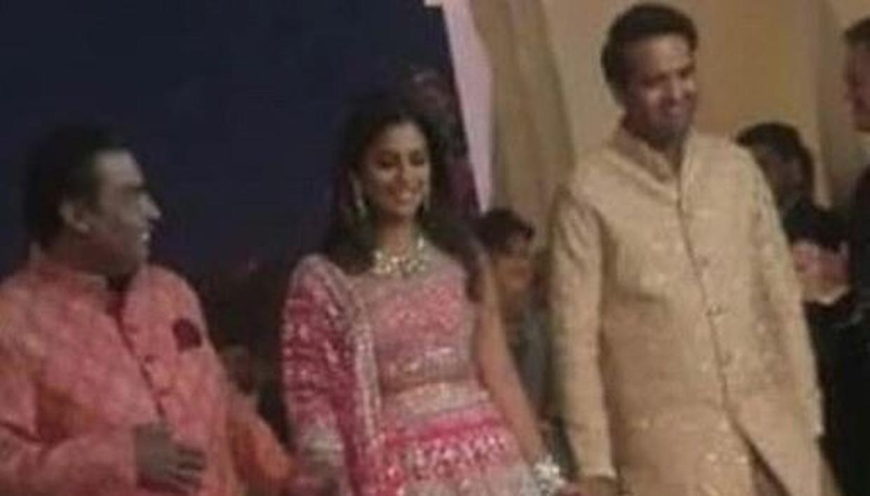 FIRST GLIMPSE: BRIDE-TO-BE ISHA AMBANI WALKS IN WITH FATHER MUKESH AMBANI AND WOULD-BE HUSBAND ANAND PIRAMAL FOR PRE-WEDDING EVENTS