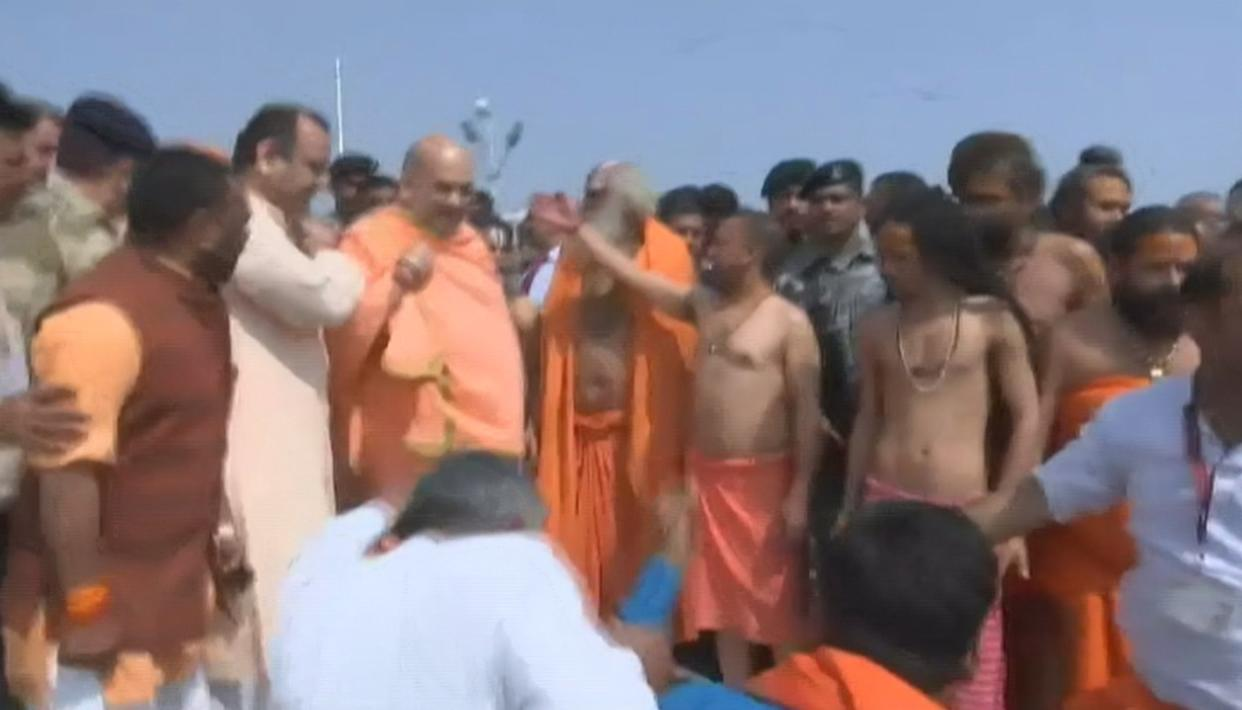 WATCH: AMIT SHAH TAKES HOLY DIP AT KUMBH