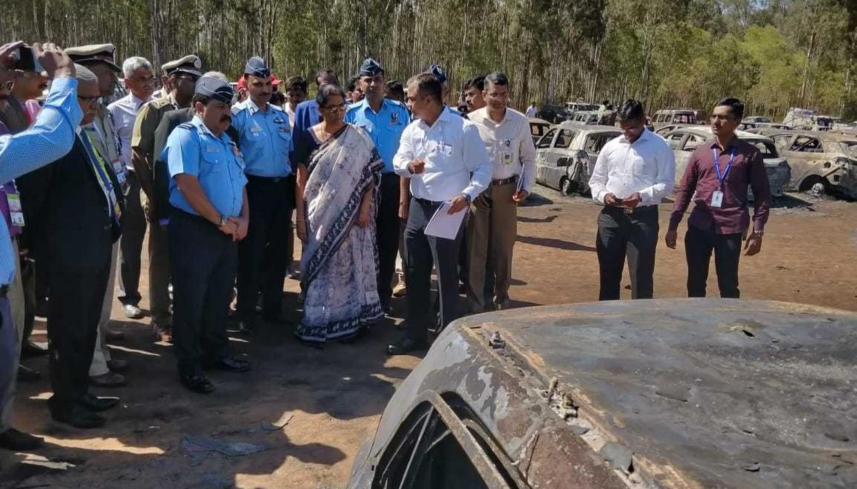 DEFENCE MINISTER SITHARAMAN INSPECTS FIRE MISHAP SITE NEAR AERO INDIA VENUE