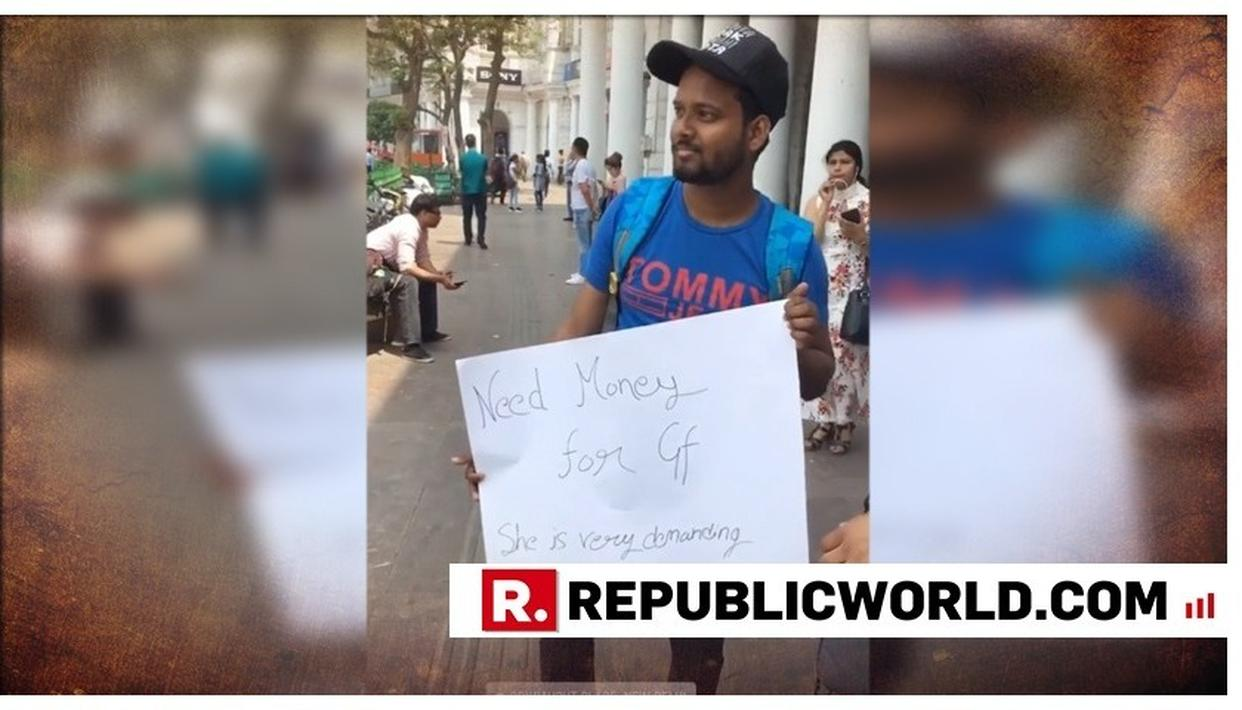 VIRAL VIDEO | 'NEED MONEY FOR GIRLFRIEND', MAN IN DELHI HOLDS A PLACARD AND IS ONLY ACCEPTING CASH TO BUY HER A RING