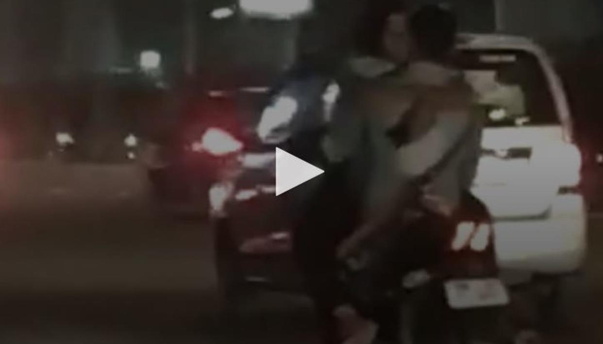 IPS OFFICER CALLS OUT COUPLE GETTING INTIMATE WHILE RIDING A BIKE ON DELHI ROADS, SHARES DANGEROUS VIDEO