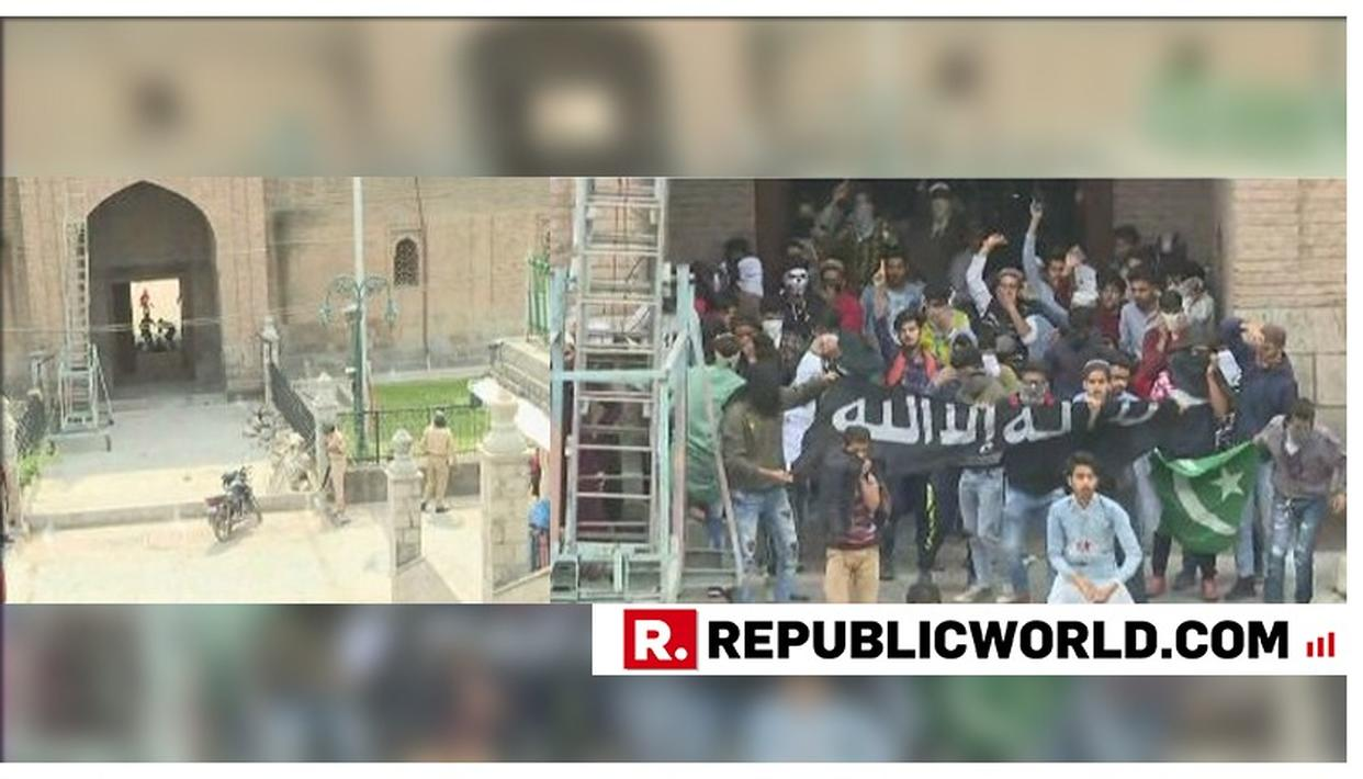YOUTH WAVE ISIS AND PAKISTAN FLAGS, PELT STONES ON SECURITY FORCES OUTSIDE KASHMIR'S JAMIA MASJID