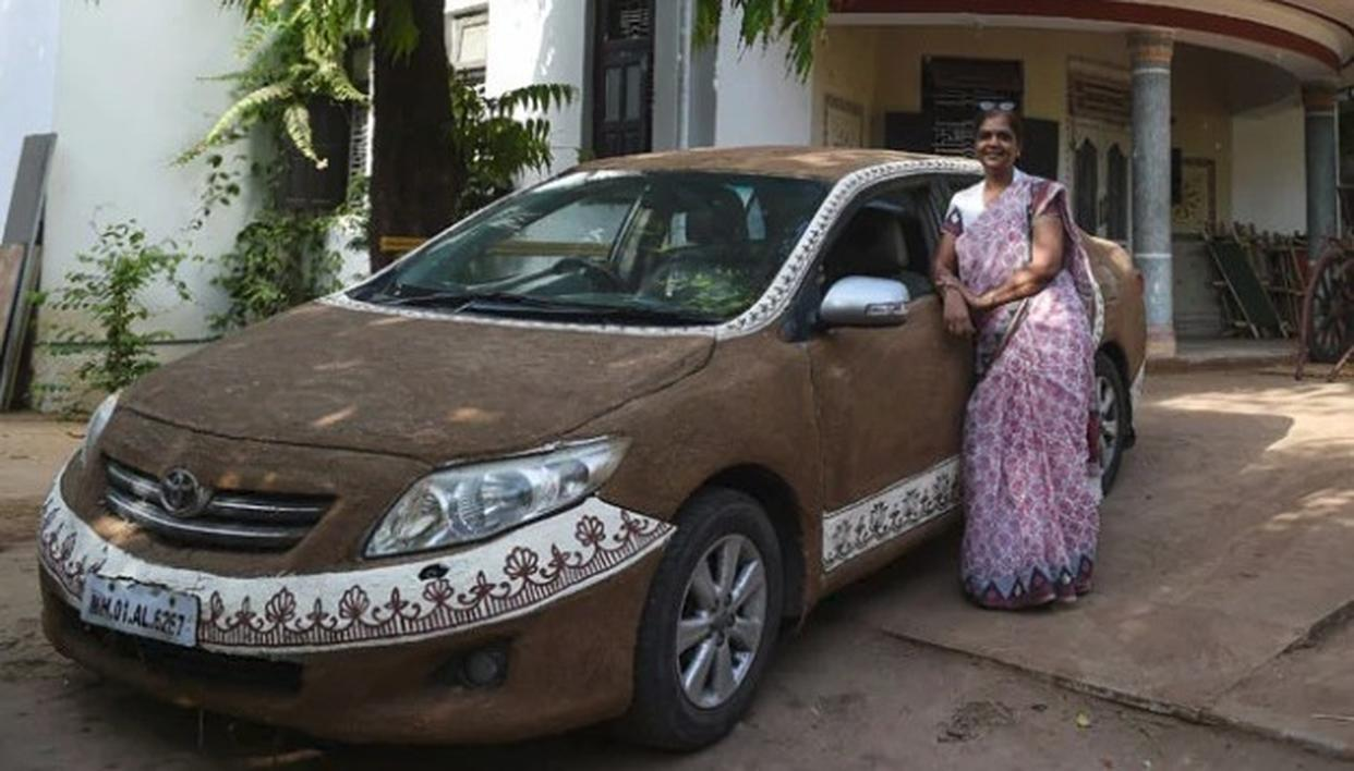 GUJARAT WOMAN COATS HER SEDAN WITH COW DUNG, PUTS RANGOLI-LIKE DESIGNS ON THE EDGES FOR THIS 'COOL' REASON