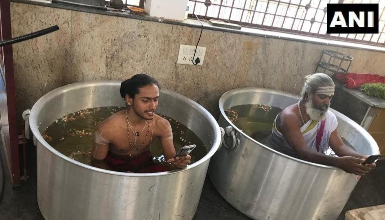 APPEALING TO THE RAIN GODS, PRIESTS IN KARNATAKA TEMPLE PERFORM RITUALS IMMERSED IN MASSIVE WATER-FILLED VESSELS