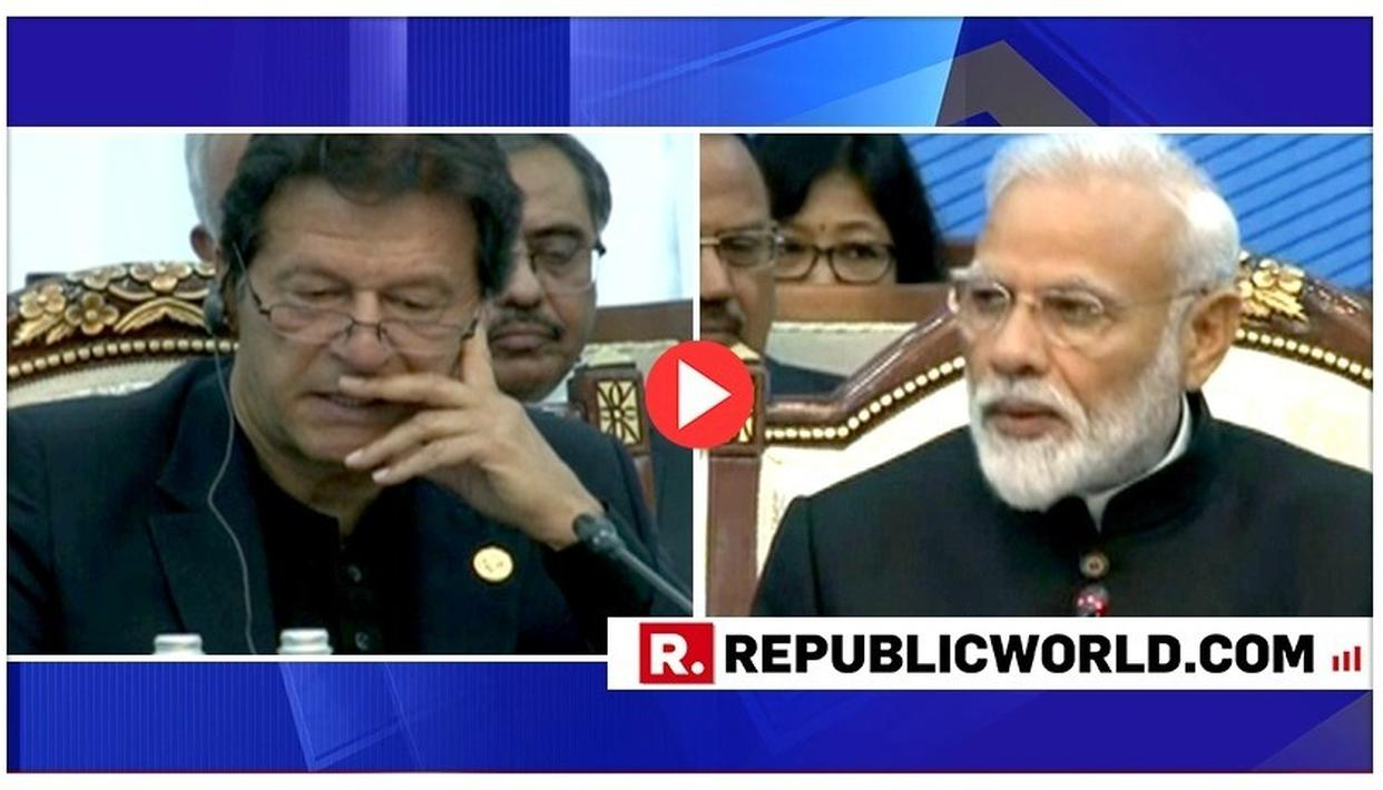 NERVOUS MUCH? WATCH IMRAN KHAN WHISPERING INTO HIS MICROPHONE WHILE PM MODI EXPOSES PAKISTAN ON TERRORISM AT SCO SUMMIT