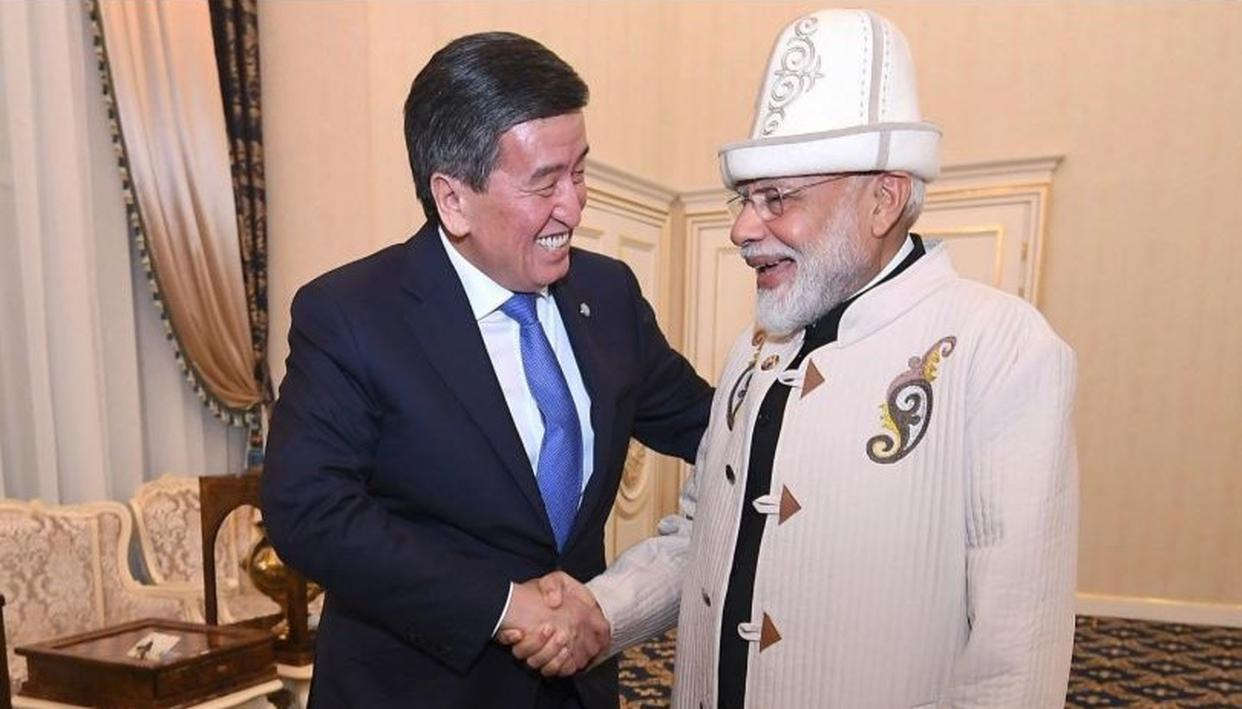 IN PICTURES | PM Narendra Modi receives a traditional hat and coat from Kyrgyzstan President Jeenbekov in Bishkek