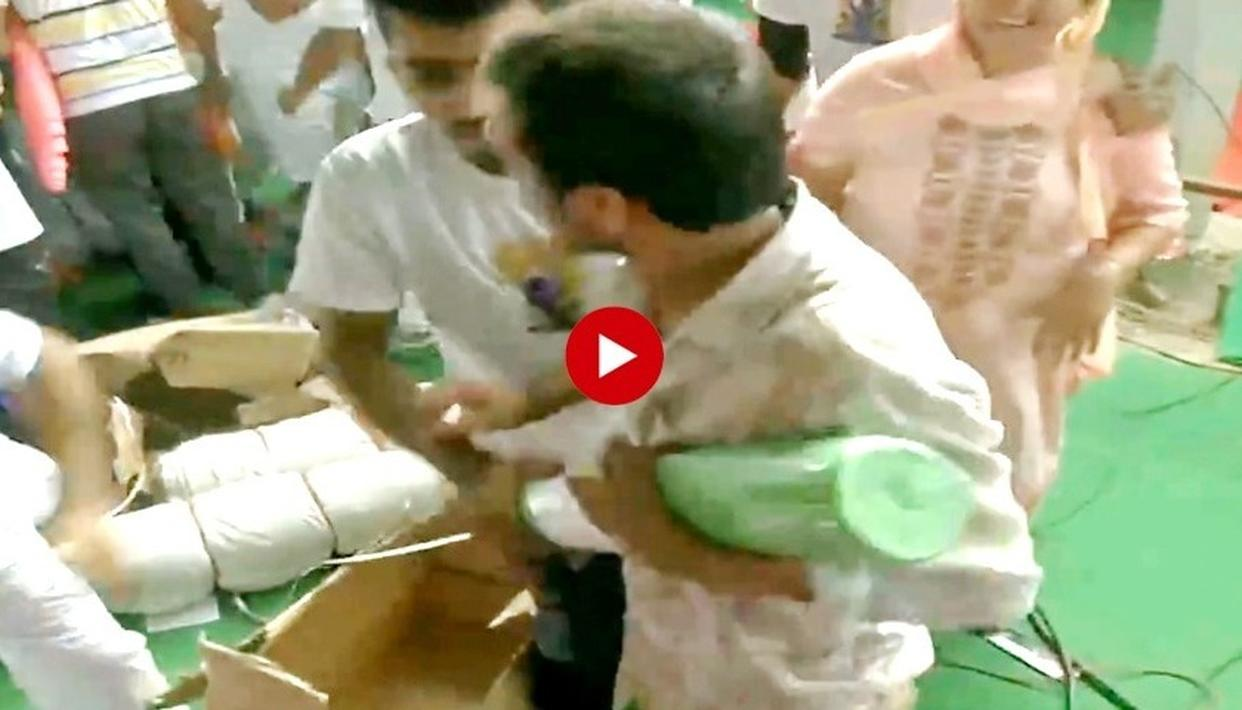 WATCH: YOGA DAY EVENT IN HARYANA'S ROHTAK TURNS CHAOTIC, PEOPLE LOOT MATS FROM VENUE AFTER THE SESSION