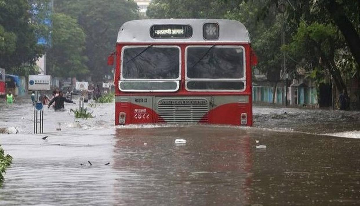 HEAVY DOWNPOUR CRIPPLES MUMBAI, PUBLIC HOLIDAY DECLARED IN THE CITY AS TRAFFIC, TRAIN SERVICES AFFECTED