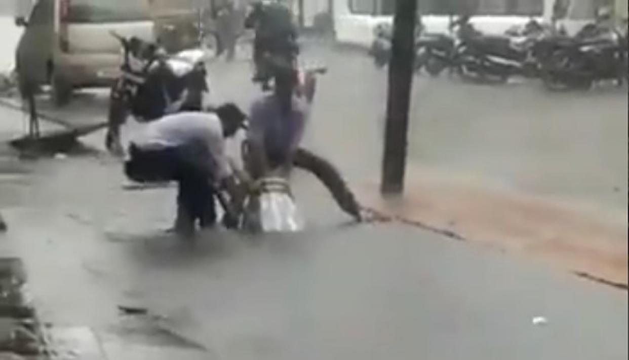 'DON'T SHARE FAKE VIDEOS': BMC CLARIFIES THAT VIRAL VIDEO OF BIKE STUCK IN FLOODED MANHOLE IS NOT FROM MUMBAI