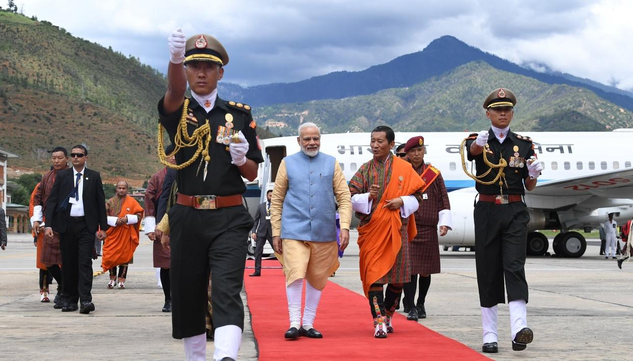 PM MODI ARRIVES IN BHUTAN, RECIEVES A GRAND WELCOME AT PARO INTERNATIONAL AIRPORT BY BHUTAN PM LOTAY TSHERING