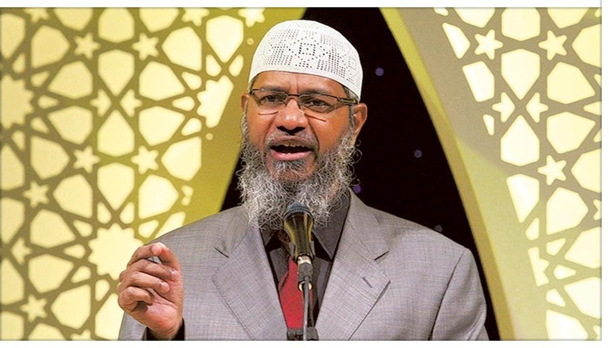 MALAYSIAN HUMAN RESOURCES MINISTER DARES ZAKIR NAIK TO FILE DEFAMATION CASE AGAINST HIM AFTER CALLING PREACHER'S COMMENTS DIVISIVE