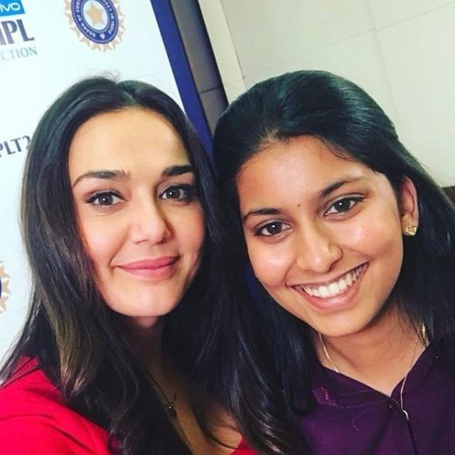 WHO IS PREITY POSING WITH?