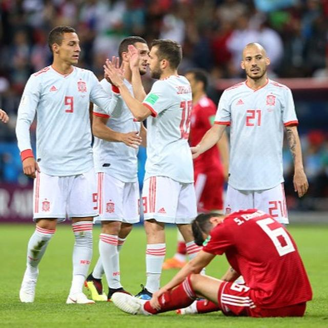 WORLD CUP: 'TOOTHLESS' SPAIN LABOUR PAST IRAN