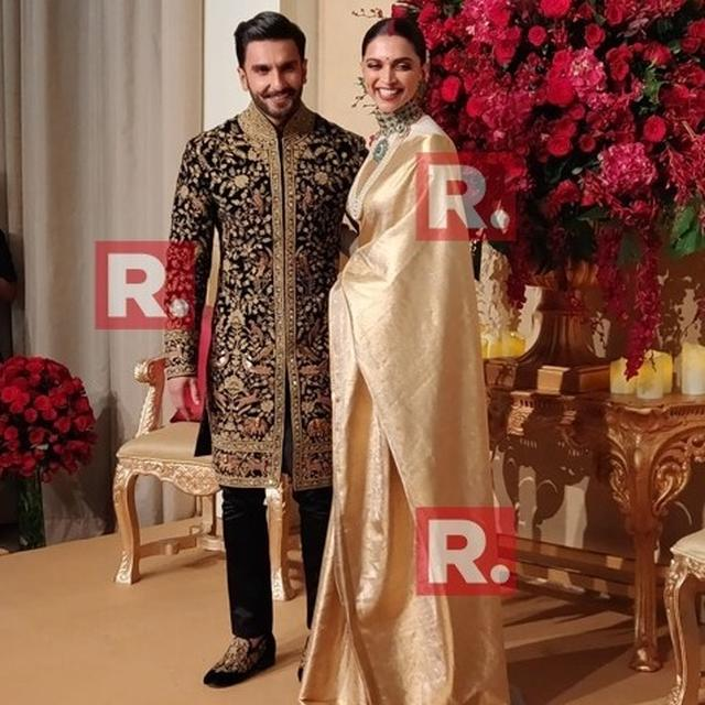 WATCH: NEWLYWEDS RANVEER-DEEPIKA WALK HAND IN HAND AS THEY GREET THE PAPARAZZI AT THEIR WEDDING RECEPTION!