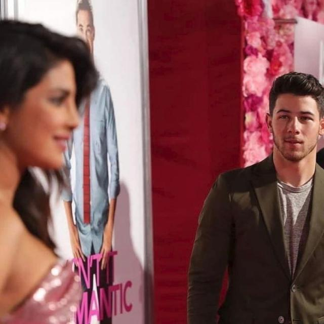 NICK JONAS REVEALS THE SECRET TO HIS LOVE-STRUCK EXPRESSION IN THIS PHOTOGRAPH WITH PRIYANKA CHOPRA