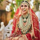 SEE PICTURE: SHLOKA MEHTA MAKES FOR A STUNNING BRIDE IN A RED AND GOLD LEHENGA FROM THE WEDDING CEREMONY