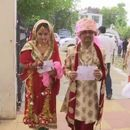 NEWLYWEDS FROM JAMMU AND KASHMIR ARRIVE IN FULL WEDDING ATTIRE TO CAST VOTES; PICTURES GO VIRAL ON INTERNET