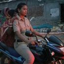 """BRAVO"": NETIZENS IN AWE OF FEMALE POLICE OFFICER FROM ODISHA RESCUING LOCALS ON A BIKE FROM CYCLONE FANI"