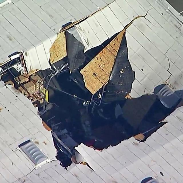 F-16 FIGHTER CRASHES INTO CALIFORNIA WAREHOUSE. PILOT EJECTS