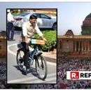 MANSUKH MANDAVIYA RIDES A BICYCLE TO RASHTRAPATI BHAVAN FOR HIS SWEARING-IN, JUST AS HE DOES TO PARLIAMENT