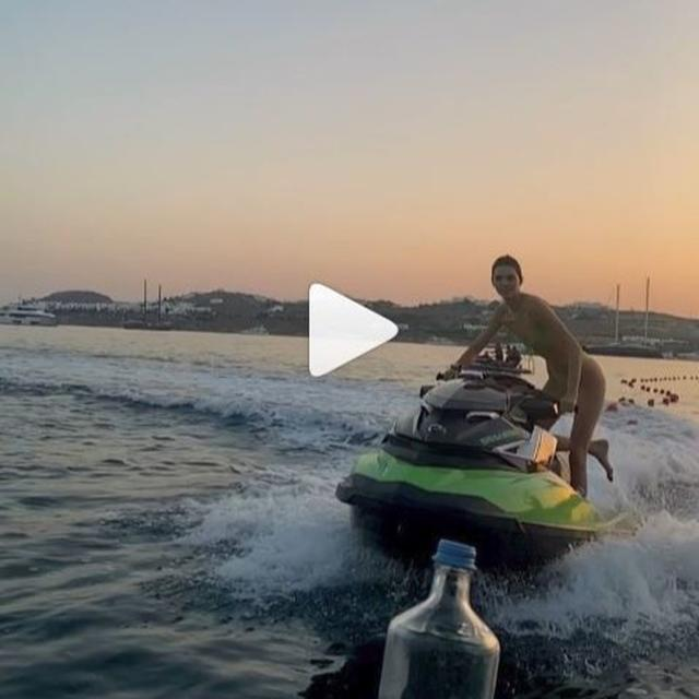 BOTTLE CAP CHALLENGE: WATCH KENDALL JENNER TAKE THE CAP OFF A BOTTLE WHILE RIDING A JETSKI