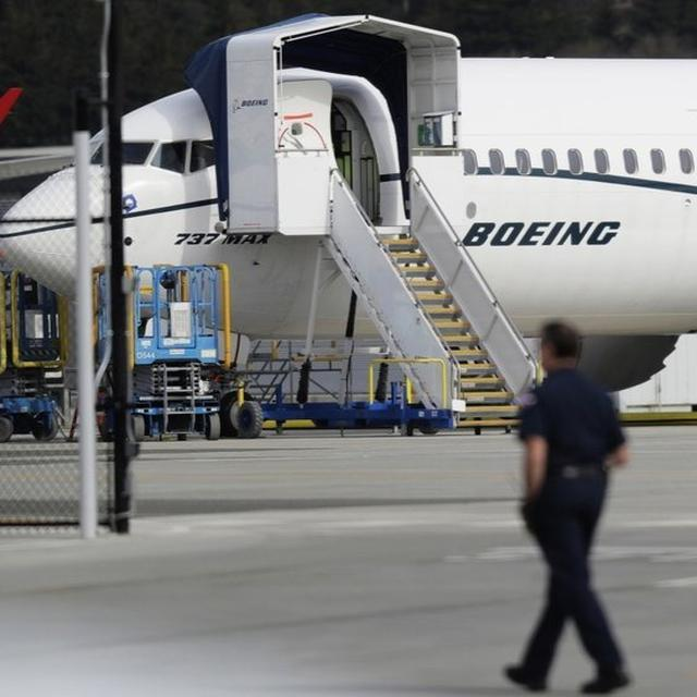 BOEING TO TAKE A $4.9 BILLION CHARGE OVER GROUNDED JET