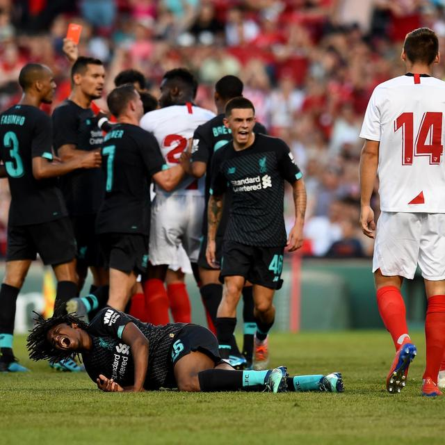 LIVERPOOL SURVIVE INJURY SCARE AS THEY GO DOWN 2-1 TO SEVILLA