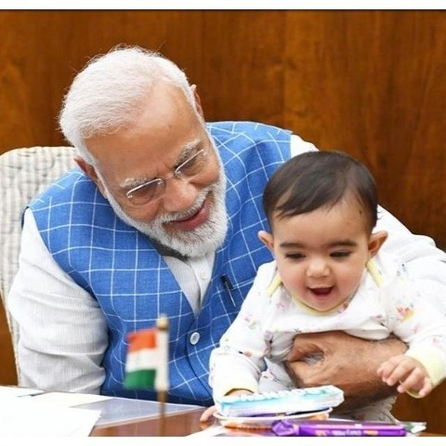 VIRAL: PM MODI SHARES PICTURES WITH 'SPECIAL FRIEND' IN PARLIAMENT, TAKES INTERNET BY STORM. FIND OUT WHO THE BABY IS HERE