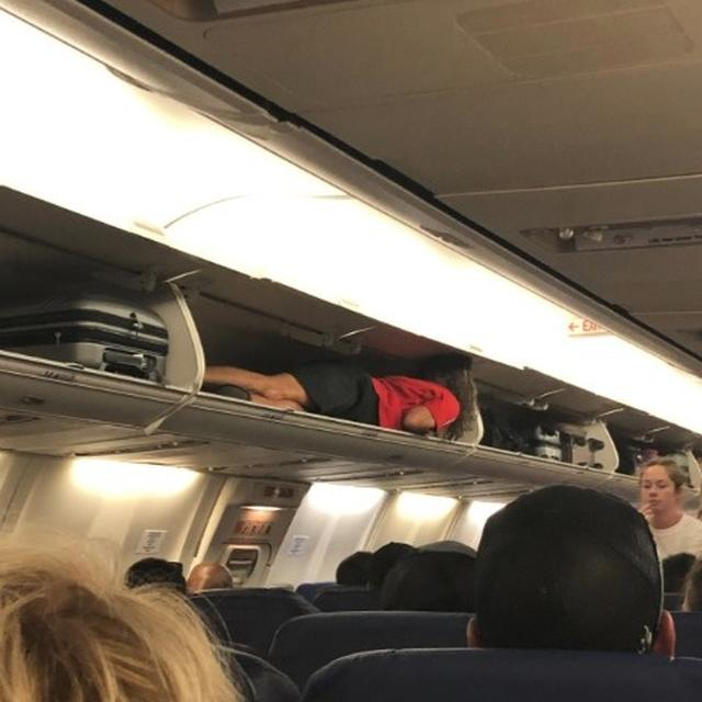 AIR HOSTESS HIDES IN OVERHEAD CABIN TO 'SURPRISE' PASSENGERS, TWITTER SPLIT BETWEEN HILARITY AND SAFETY CONCERNS